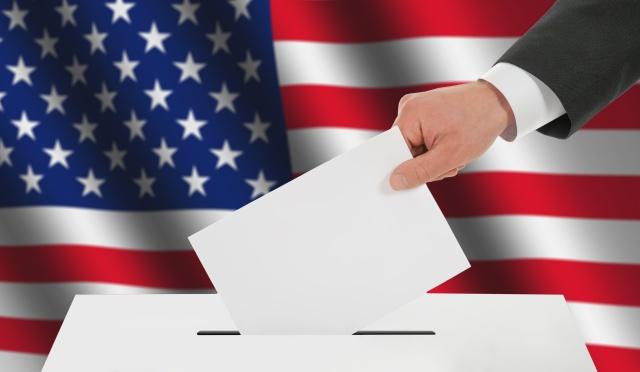 Man's hand down the ballot